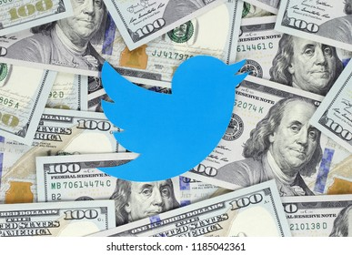 Kiev, Ukraine - September 07, 2018: Twitter bird icon printed on paper and placed on money background. Twitter is an American online news and social networking service.