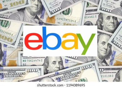 Kiev, Ukraine - September 07, 2018: Ebay logo printed on paper and placed on money background. Ebay is an American multinational e-commerce corporation.