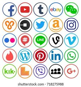 Kiev, Ukraine - September 11, 2017: Collection of popular round social media icons, printed on paper: Facebook, Twitter, Google Plus, Instagram, Pinterest, LinkedIn, Tumblr and others
