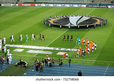 """KIEV, UKRAINE - SEPTEMBER 14, 2017: UEFA Europa League match between FC DYNAMO KIEV and FC SKENDERBEU at the National Sports Complex """"Olympic"""". Logo of the League of Europe. Greeting commands."""