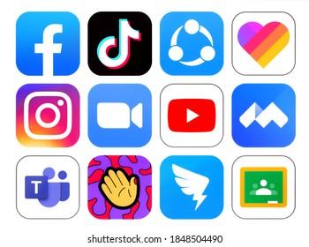 Kiev, Ukraine - September 14, 2020: Set of popular social media Apps icons, such as: Facebook, Likee, Instagram, Zoom, Tiktok, Youtube, DingTalk, ShareIt, printed on white paper