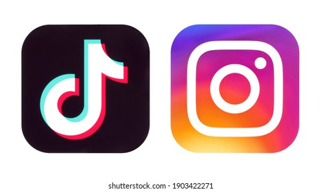 Kiev, Ukraine - September 14, 2020: TikTok and Instagram icons on white background close-up, printed on paper. TikTok is a viral Chinese video-sharing social networking service. IT IS NOT ILLUSTRATION
