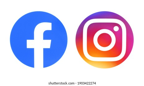 Kiev, Ukraine - September 14, 2020: Facebook and Instagram round icons printed on white paper. IT IS NOT ILLUSTRATION