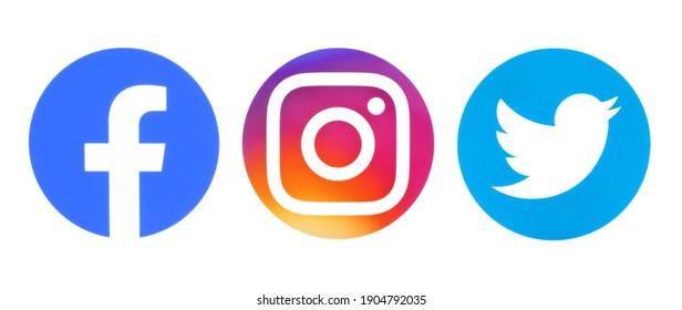 Kiev, Ukraine - September 14, 2020: Facebook, Instagram and Twitter round icons printed on white paper