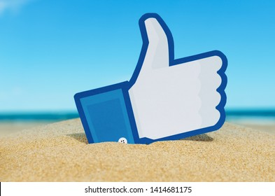 Kiev, Ukraine - September 15, 2016: Facebook like logo for e-business, web sites, mobile applications, banners, printed on paper and placed in the sand against the sea. Social network facebook sign.