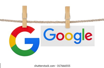 KIEV, UKRAINE - SEPTEMBER 16, 2015: Logo largest Internet search engine Google hanging on the clothesline isolated on white background.Google it is the largest Internet search engine, owned of Google