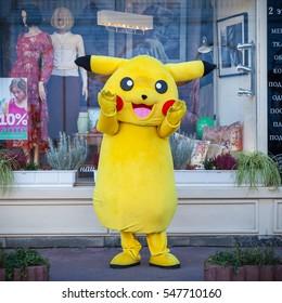 KIEV, UKRAINE - SEPTEMBER 17, 2016: Happy Pokemon Pikachu mascot near shop showcase in Kiev, Ukraine.