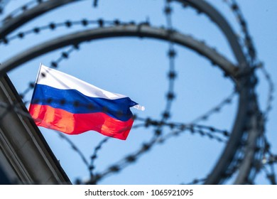KIEV, UKRAINE - September 18, 2016: Flag and barbed wire on the building of the Embassy of Russian Federation in Kiev, Ukraine.