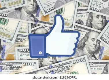 Kiev, Ukraine - September 18, 2018: Facebook Like logo printed on paper and placed on money background. Facebook is an American online social media and social networking service company
