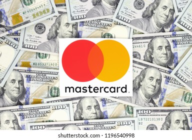 Kiev, Ukraine - September 18, 2018: Mastercard logo printed on paper and placed on money background. Mastercard is an American multinational financial services corporation