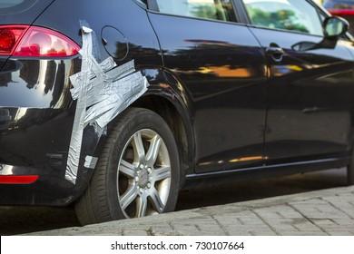 Kiev, Ukraine - September 20, 2017: Damaged car with duct tape repair