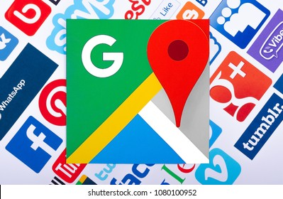 Kiev, Ukraine - September 21, 2015:  Google Maps logo printed on paper and placed on of social media  background. Google Maps a set of applications map service and technology provided by the  Google.