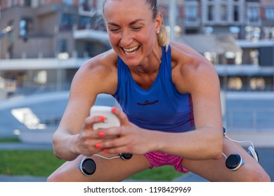 Kiev Ukraine September 21, 2018: Compex pacemaker for fitness. Install electrostimulator on the muscles of the legs. Fitness training with an electrostimulator.