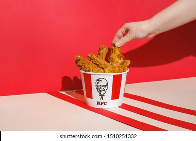 Kiev, Ukraine - September 21, 2019: KFC chicken. Hand holds chicken leg