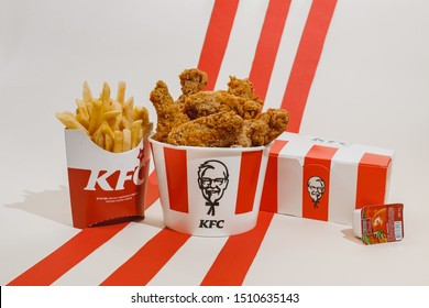 Kiev, Ukraine - September 21, 2019: KFC menu: fried chicken, nuggets, french fries and ketchup