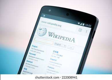 Kiev, Ukraine - September 22, 2014: Close-up shot of brand new Google Nexus 5, powered by Android 4.4 version, with Wikipedia website homepage on a screen.