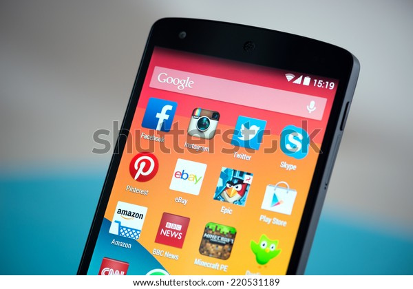 Kiev, Ukraine - September 22, 2014: Close-up shot of brand new Google Nexus 5, powered by Android 4.4 version, with various mobile applications on a screen.