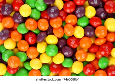 Kiev, Ukraine - September 22, 2017: Skittles multicolored fruit candies background. Skittles is a brand of fruit-flavoured.