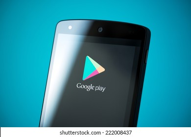 Kiev, Ukraine - September 24, 2014: Close-up shot of brand new Google Nexus 5, powered by Android 4.4 version, with Google Play logotype on a screen.