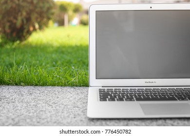KIEV, UKRAINE - SEPTEMBER 25, 2017: Apple MacBook Air, outdoors