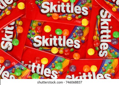 Kiev, Ukraine - September 27, 2017: Skittles multicolored fruit candies packages background. Skittles is a brand of fruit-flavoured sweets, currently produced and marketed by the Wrigley Company.