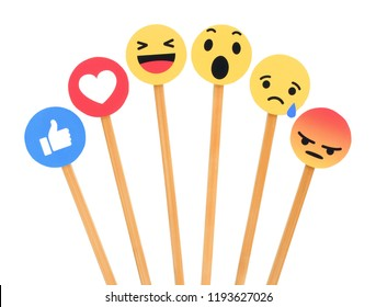 Kiev, Ukraine - September 27, 2018: Facebook like button 6 Empathetic Emoji Reactions printed on paper and put on wooden sticks on white background