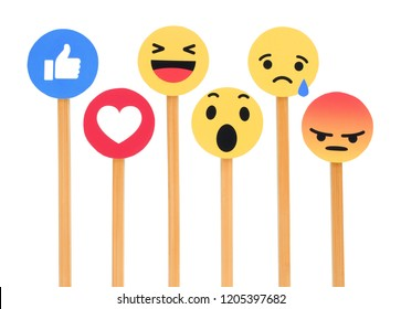 Kiev, Ukraine - September 27, 2018: Facebook like button 6 Empathetic Emoji Reactions printed on paper, cut and put on wooden sticks on white background