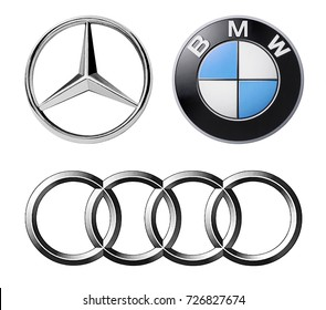 Kiev, Ukraine - September 28, 2017: Set of logos popular German brands of cars: Mercedes, BMW and Audi, printed on paper and placed on white background.