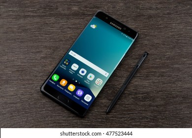 Kiev, Ukraine - September 3, 2016: Studio shot of a Samsung Galaxy Note 7 smartphone, with 12 mP Camera, Exynos 8890 Octa and 5.7 display, 2560   1440 resolutionc on wood.