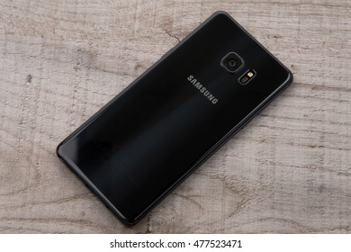 Kiev, Ukraine - September 3, 2016: Studio shot of a back Samsung Galaxy Note 7 smartphone, with 12 mP Camera, Exynos 8890 Octa and 5.7 display, 2560   1440 resolution on wood.