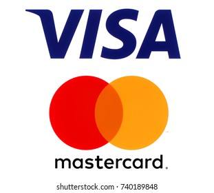 Kiev, Ukraine - September 30, 2017: Visa and Mastercard logos printed on white paper. Visa and Mastercard are an American multinational financial services corporations