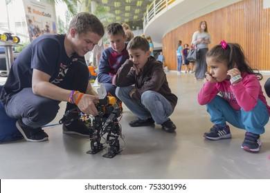 Kiev, Ukraine - September 30, 2017: Children get acquainted with robotics at the festival of STEM-education