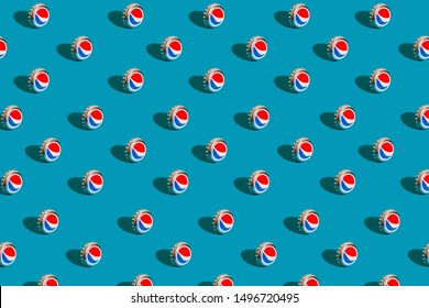Kiev, Ukraine - September 5, 2019: Pepsi aluminum caps on a blue background. Pattern