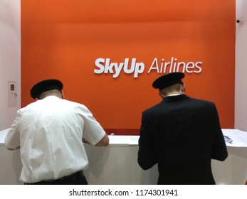 KIEV, UKRAINE - SEPTEMBER 7, 2018: Sky Up Airlines registration zone in airport. Two pilots fill documents before departure