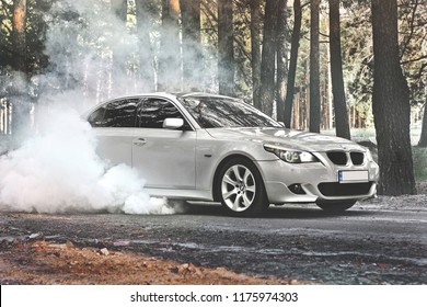 Kiev, Ukraine - September 9, 2018. BMW car Drifts in the forest. BMW E60 Burnout