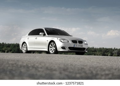 Kiev, Ukraine - September 9, 2018. BMW E60 on the road against the sky. Car view from below