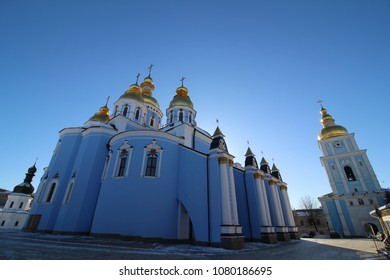 KIEV, UKRAINE - St. Michael's Golden-Domed Monastery with the bell tower, sunny tourism travel