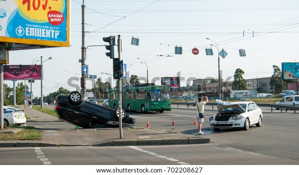 Kiev, Ukraine-August, 19, 2017: car accident with an inverted car at the intersection of Alisher Navoi Avenue and Perova Blvd.