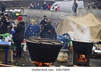 KIEV, UKRAINE-DECEMBER 18: EuroMaydan  on 18 December 2013 in Kiev. Field kitchen with two big cauldrons, peoples, tent and photographer under open sky on Square of Independence