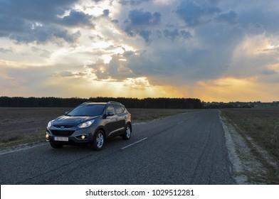 KIEV, UKRAINE-JULY 1, 2017:SUV Hyundai ix35 parked on the asphalt road. Car travel. Beautiful summer landscape wiht auto. Toward adventure! Automotive photography. Space for text. Background with car.