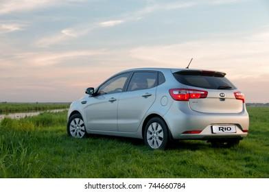 KIEV, UKRAINE-JULY 4, 2017: Kia Rio parked on the field.  Automotive photography.  Nature background with car.