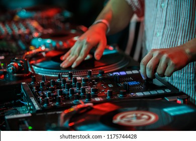 KIEV-11 JULY,2018: Hands of club dj scratching vinyl records on retro turntables player.Professional disc jockey scratches tracks with Technics SL 1210 turn table at hip hop music festival Bazar