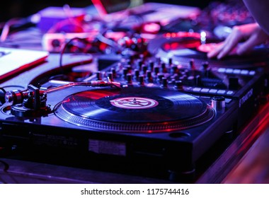 KIEV-11 JULY,2018: Professional concert dj setup with retro Technics SL-1210 turntables and Pioneer sound mixer in night club on stage.Scratch hip hop records with music on music festival Bazar