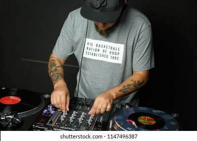 KIEV-28 JULY,2018: Hip hop DJ 13 Ice plays live vinyl music set in Prodj studio.Professional disc jockey mix musical tracks with retro Technics SL 1210 turntables and modern Pioneer DJM sound mixer