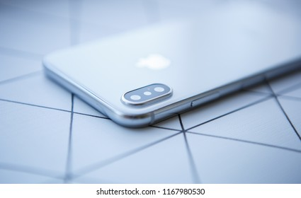 KIEV-30 AUGUST,2018: Iphone X in close up.White modern Apple Iphones 10 model with top class dual camera lenses module and infinity edge touch screen display. Luxury smartphone device in macro