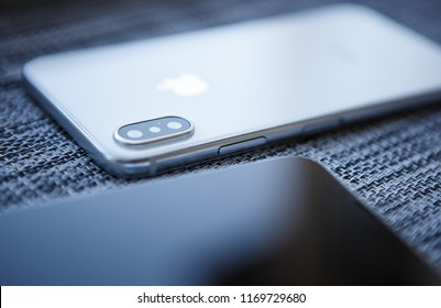 KIEV-30 AUGUST,2018: Iphone X in close up.Two modern Apple Iphones 10 model with top class dual camera lenses module and infinity edge touch screen display. Luxury smartphone device in macro