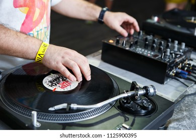 KIEV-30 JUNE,2018: Club party dj Panchez scratches vinyl records with music on professional turn table device.Pro disc jockey audio equipment in the club.Musician plays set with retro turntables