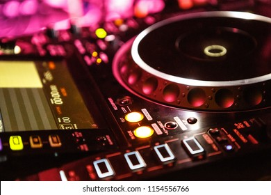 KIEV-4 JULY,2018: Modern digital DJ cd player turn table device on concert stage.Play musical tracks in the night club with Pioneer CDJ touch screen turntable.Professional audio equipment on scene
