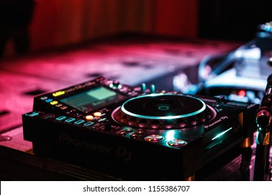 KIEV-4 JULY,2018: Pioneer CDJ turntable player on concert stage.Place and remix techno music at entertainment event in night club.Professional dj audio equipment for live performance
