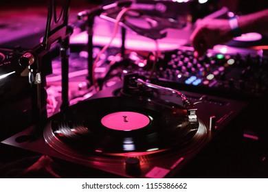 KIEV-4 JULY,2018: Professional dj setup on stage in the club.Techno music party in nightclub.Disc jockey plays musical tracks with retro Technics vinyl player device